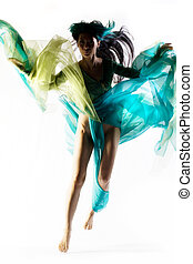 Color splash - Girl jumping wearing bright colorful robe