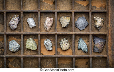 metamorphic rock geology collection in old, wooden...