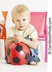 portrait of toddler with a ball