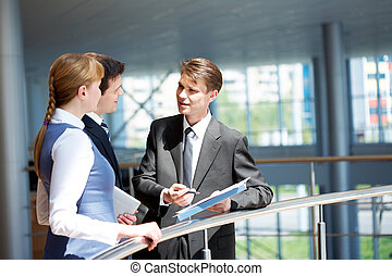 People at work - Photo of confident businessman sharing his...