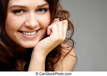 Happiness - Portrait of happy female touching her face and...