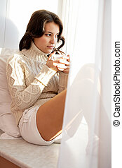 Warm moment - Portrait of charming girl in sweater holding...