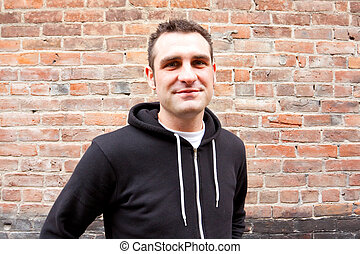 Male Model Portrait - A man wears a stylish black sweatshirt...