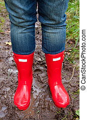 Red Rain Boots - Bright shining clean red rain boots on a...