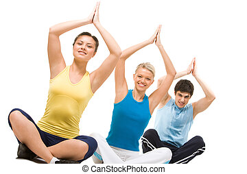 Yoga - Photo of meditating group sitting with their arms...