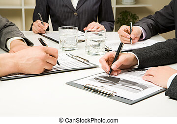 At meeting - Photo of business people hands working with...