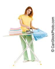 Woman ironing - Portrait of young female ironing towels at...