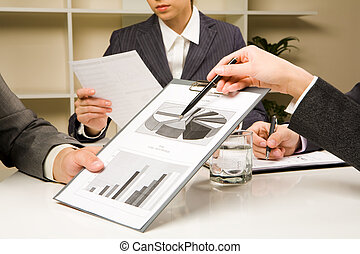 Explanation - Image of human hands during paperwork at...
