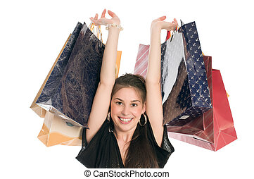 Happy shopper - Young happiness girl holding paper bags and...
