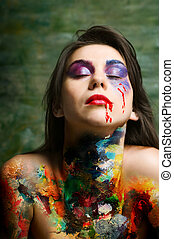 Paint woman - Young woman with art oil paints over naked...