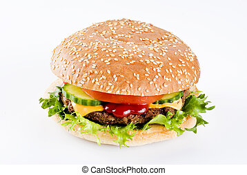 Beefburger in sesame seed bun with vegetables isolated
