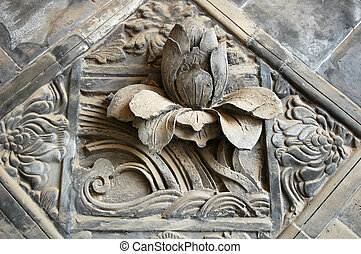 Brick carvings of lotus flower,Chinas traditional handcrafts...