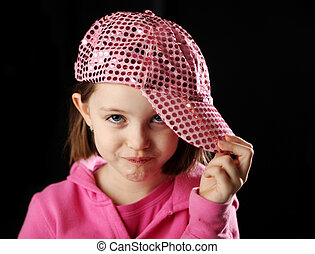 Female child wearing sparkly pink baseball cap - Young girl...