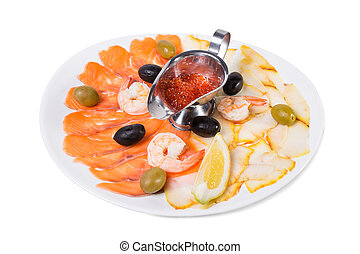 Delicious smoked fish platter with lemon. - Delicious smoked...