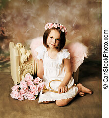 Angel Girl - Beautiful young girl wearing angel wings and...
