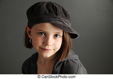 Girl wearing newsboy cap - Close up of a beautiful young...