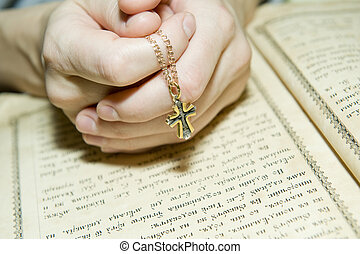 Prayerful - Female hands during reading of a prayer against...