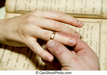 Betrothal - The mans hand dresses a ring on a female finger...