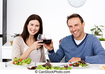 A happy couple drinking red wine - Portrait of a happy...