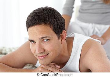 Happy man being massaged