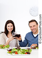 Lovely couple drinking red wine while having lunch in the...