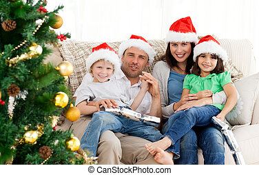 Portrait of a family at Christmas on the sofa