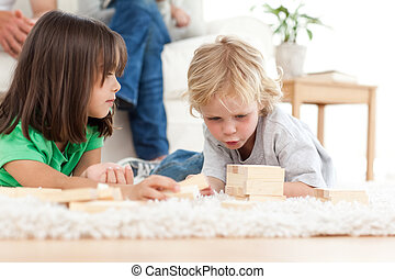 Little boy playing dominoes