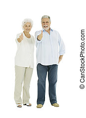 happy elderly couple with a thumbs-up