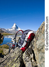 Backpack in front of the Matterhorn in the swiss alps