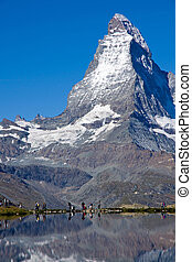 Tourists in front of the Matterhorn - Tourists in front of...