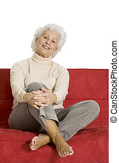 elderly woman relaxing on the couch