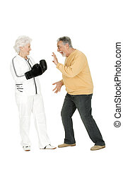 elderly couple with boxing gloves