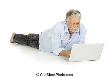 elderly man using laptop