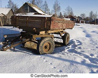 Rusty farm trailer under snow - Abandoned rusty farm trailer...