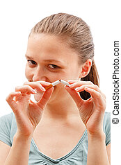 Stop smoking - Woman breaking cigarette in two, meaning stop...