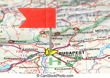 Budapest - famous city in Hungary. Red flag pin on an old...