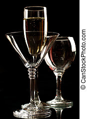 Champagne, wine and martini glasses isolated on black