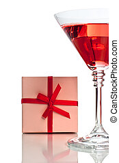 Red cocktail with gift box