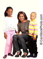 Happy family portrait - Smiling mommy with children in happy...