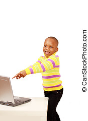 Excited kid pointing to computer