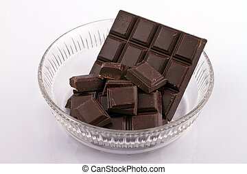 Glass bowl with chocolate - Chocolated pieces in glass bowl...