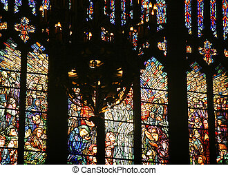 Stained glass from a Catholic church with chandelier in...