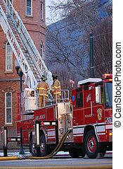 Fire Truck - Fire truck outside a building on fire.