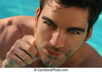 Man in water - Close up portrait of young man in pool...