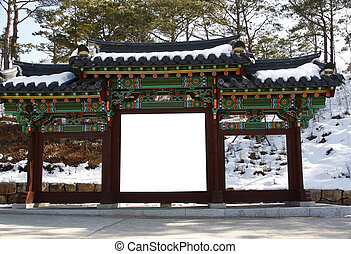 Blank billboard on a korean gate temple during winter-put...