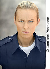 Blue Collar woman - Young female cop portrait