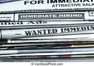 Classified ads - stack of newspaper with Classified...