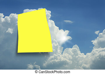 Yellow paper in a blue sky background