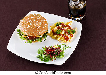 Beefburger meal - Beefburger with crispy salad leaves and...