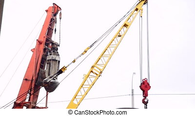 construction crane bucket for digging holes under the piles